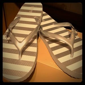 MK Silver flip flops